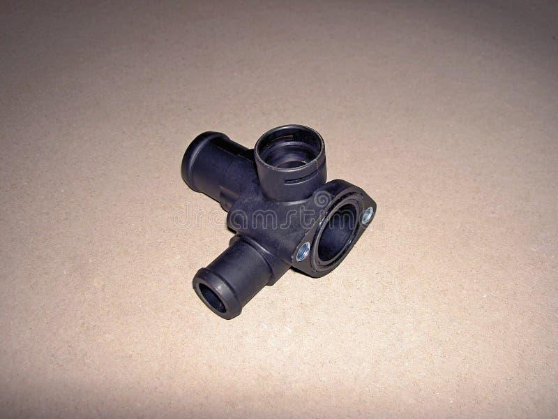 Parte plástica do sistema de distribuição da água refrigerando no carro fotografia de stock