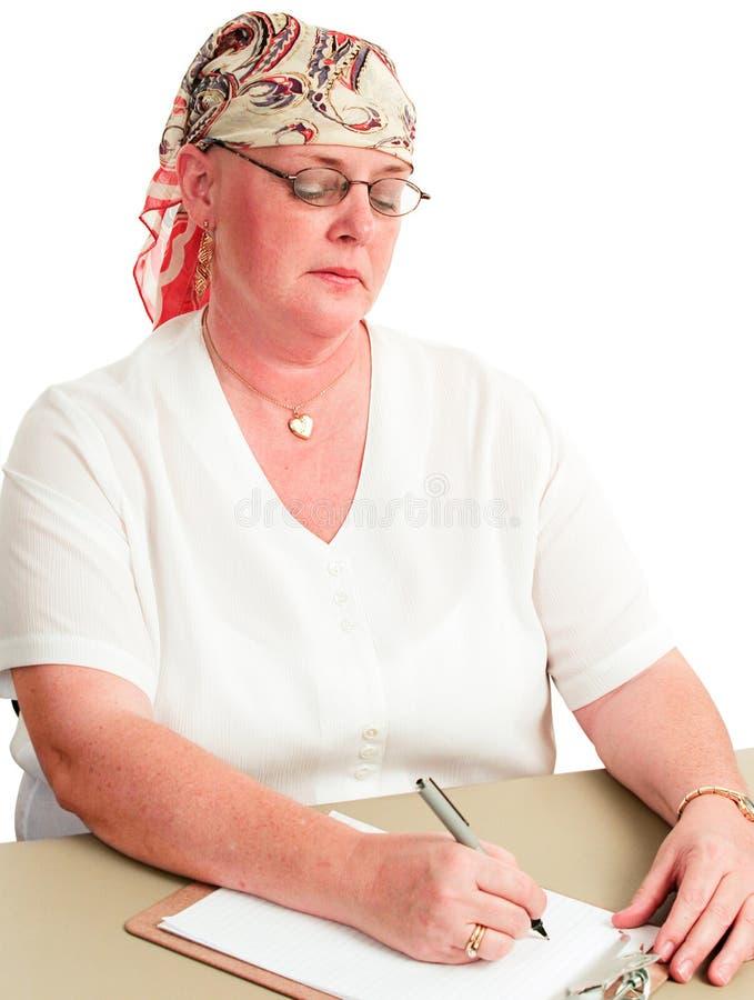 Parte posterior del paciente de la quimioterapia en el trabajo fotografía de archivo