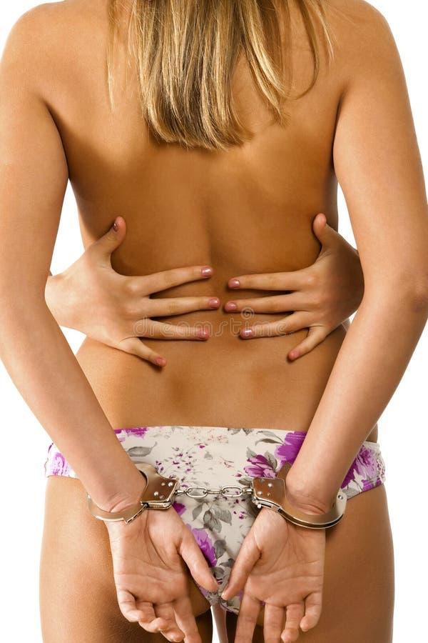 Parte posteriore del `s della donna con la manetta immagine stock libera da diritti