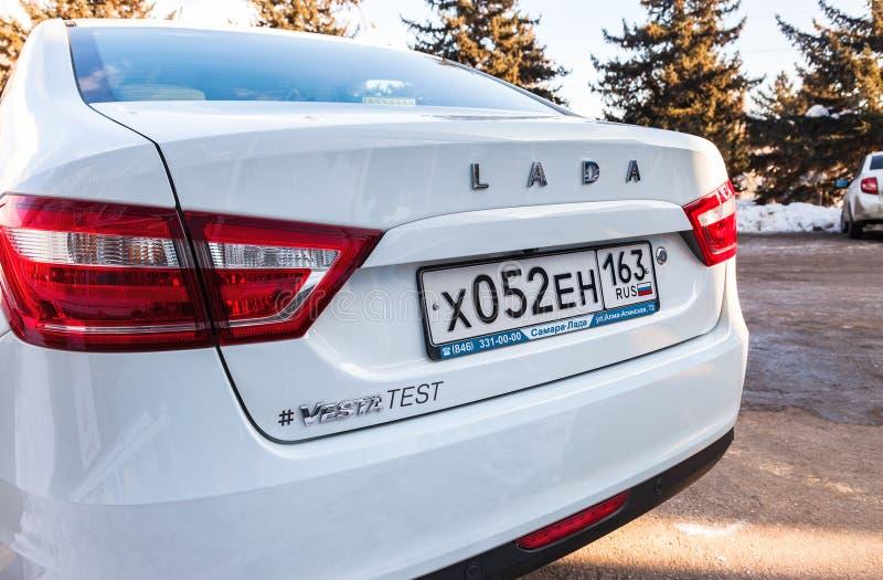 Parte posteriore di nuova automobile russa Lada Vesta con la targa di immatricolazione immagine stock libera da diritti
