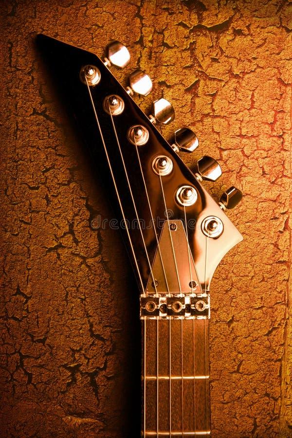 Parte superior da guitarra sobre o fundo do grunge fotografia de stock royalty free