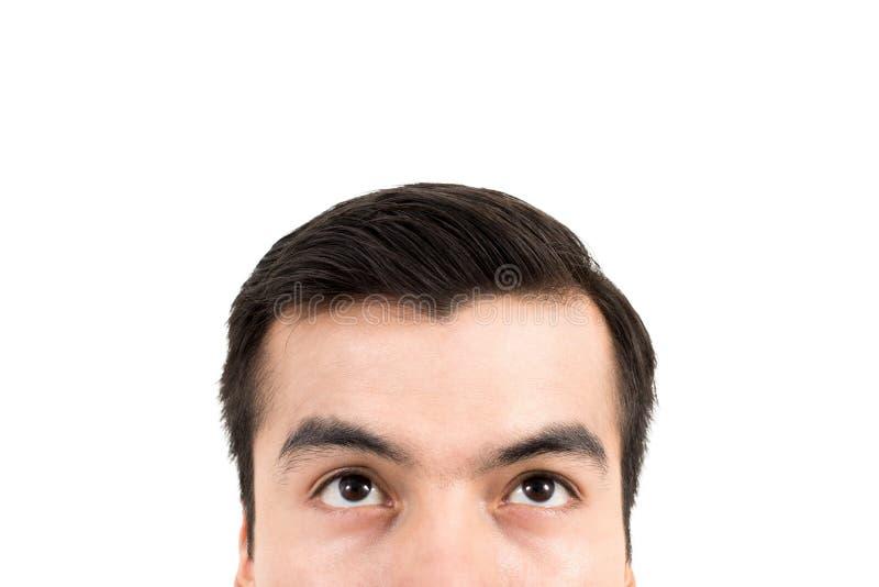 Parte superior do homem - meia cara com os olhos que olham acima fotos de stock