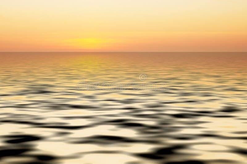 Parte traseira abstrata do oceano e do por do sol imagens de stock royalty free