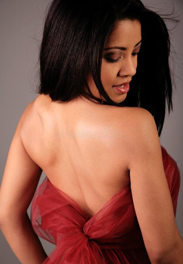 Parte traseira bonita da fêmea fotografia de stock