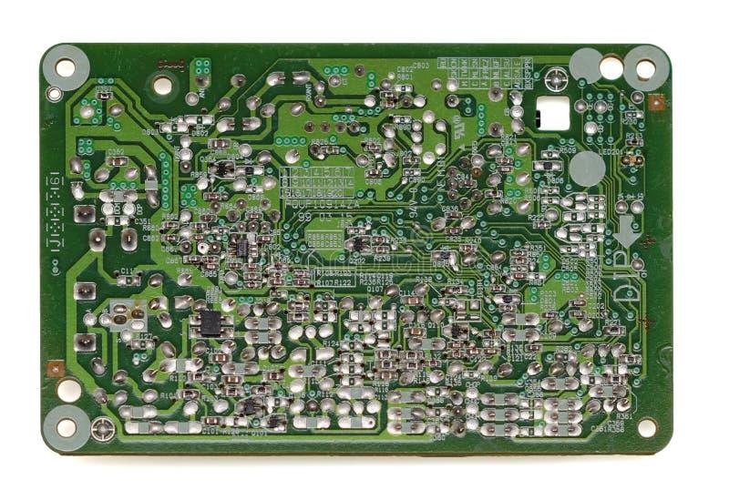 Parte traseira da placa de circuito eletrônico velha isolada no branco fotos de stock