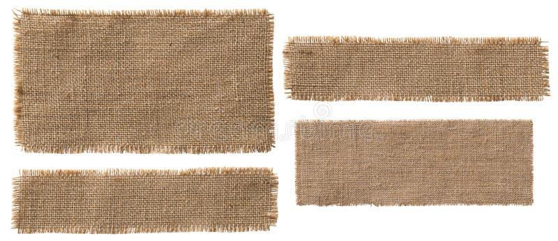 Partes da etiqueta da tela de serapilheira, pano de saco rasgado da juta remendo rústico fotos de stock royalty free