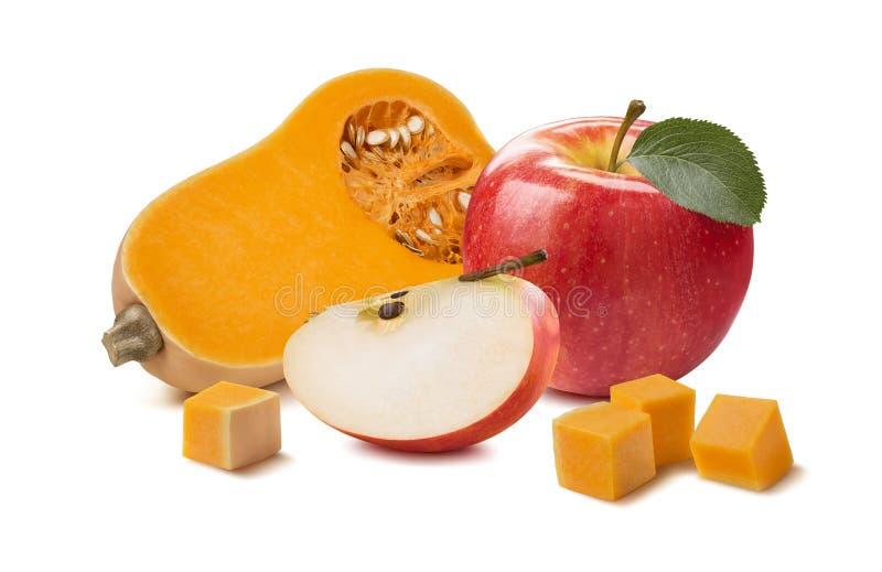 Partes da maçã da abóbora do Butternut isoladas no fundo branco imagens de stock
