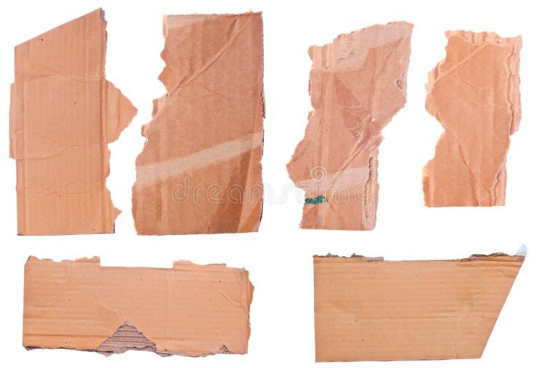 Partes de cartão ondulado marrom rasgado foto de stock royalty free