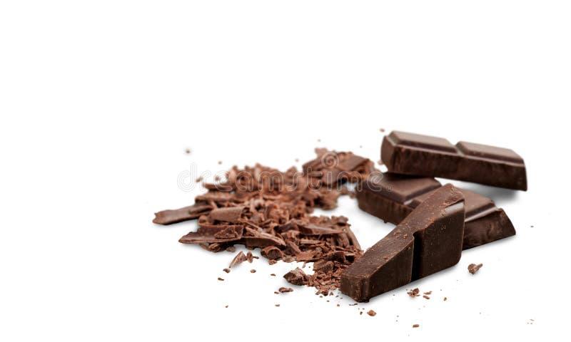 Partes de chocolate delicioso isoladas no branco imagem de stock royalty free