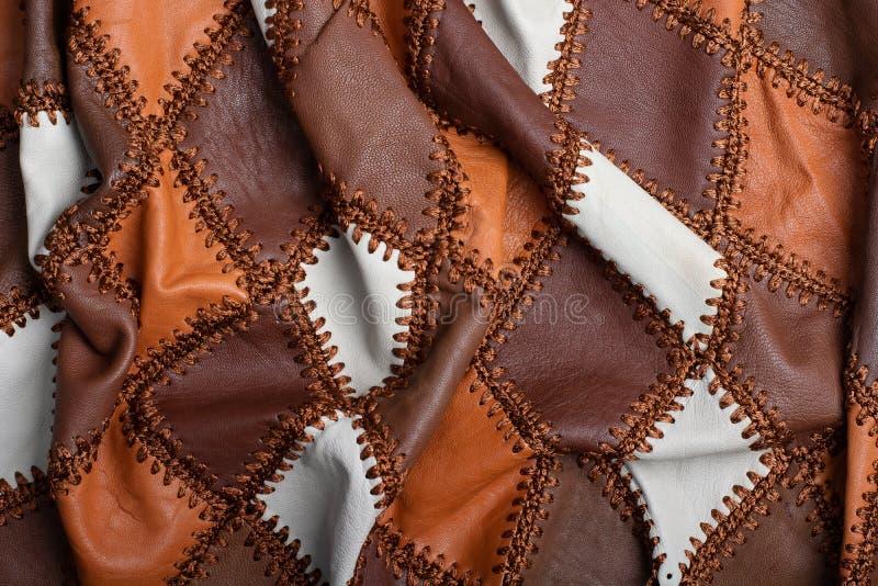 Partes de couro multi-colorido costurado com linha, tela amolgada imagens de stock royalty free