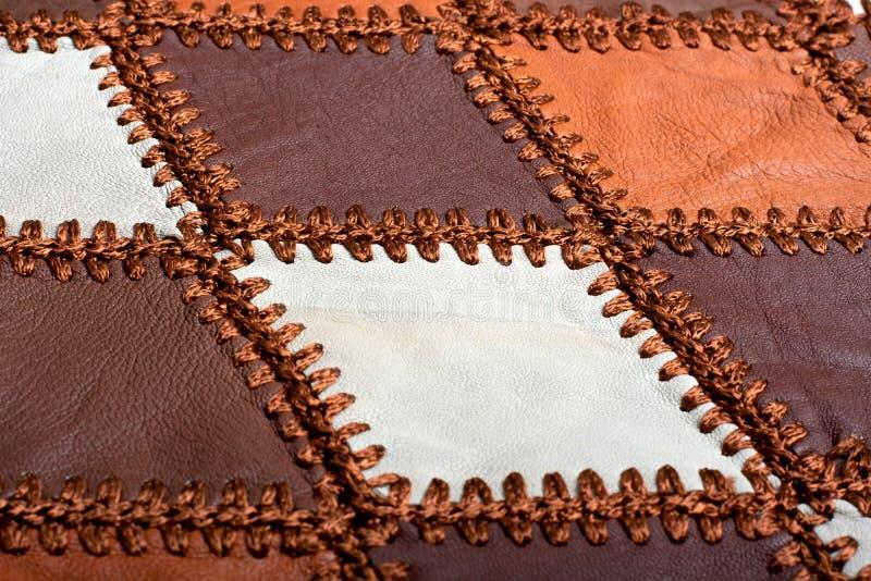 Partes de couro multi-colorido costurado com linha imagem de stock