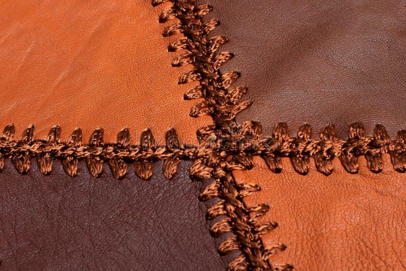 Partes de couro multi-colorido costurado com linha fotos de stock