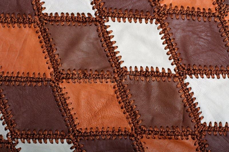 Partes de couro multi-colorido costurado com linha imagem de stock royalty free