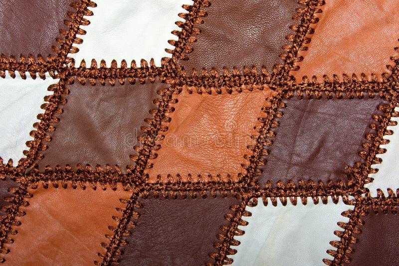 Partes de couro multi-colorido costurado com linha foto de stock royalty free