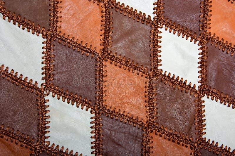 Partes de couro multi-colorido costurado com linha imagens de stock royalty free