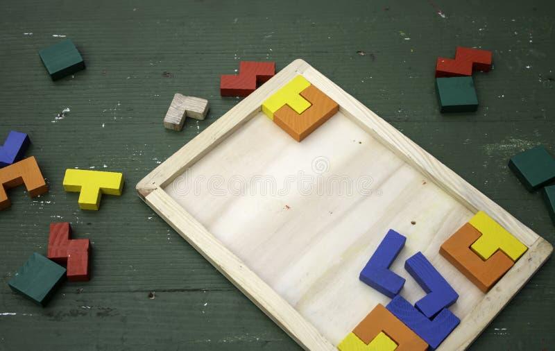 Partes de madeira do enigma foto de stock