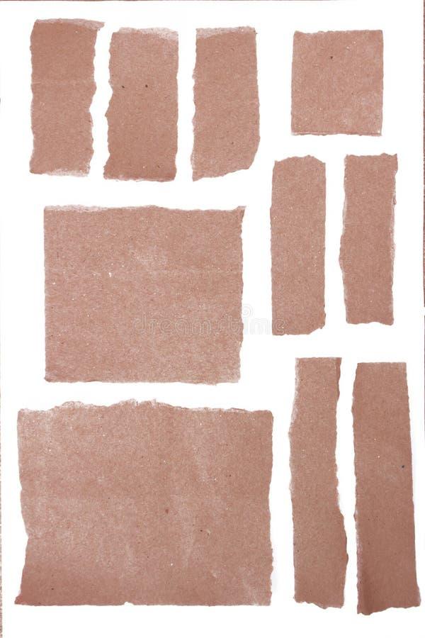 Partes de papéis velhos do Grunge isolados no branco fotografia de stock royalty free