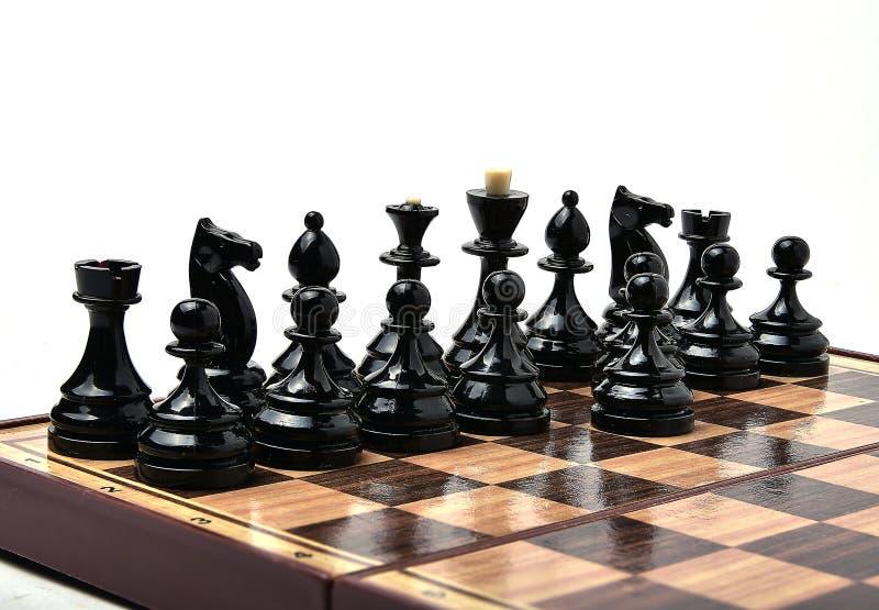 Partes de xadrez pretas no fundo branco imagens de stock