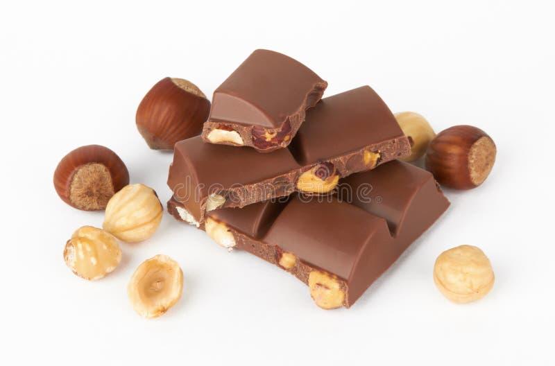 Partes do chocolate com porca fotos de stock royalty free