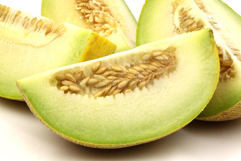 Partes frescas do melão do galia fotos de stock