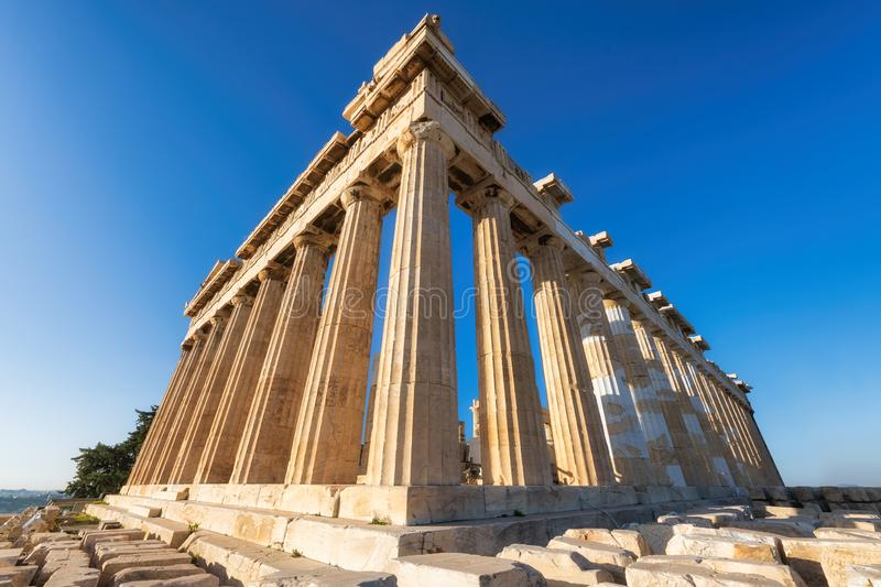 The Parthenon temple in Acropolis, Athens, Greece. The Parthenon temple at morning time with blue sky in Acropolis, Athens, Greece royalty free stock photo