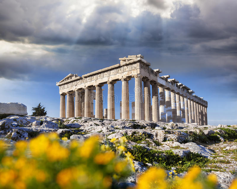 Parthenon temple with spring flowers on the Acropolis in Athens stock images
