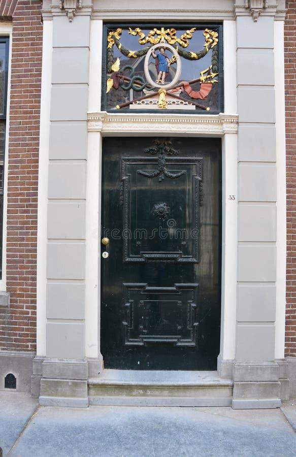 Parti anteriori delle case olandesi - Amsterdam, Olanda, Paesi Bassi fotografia stock libera da diritti