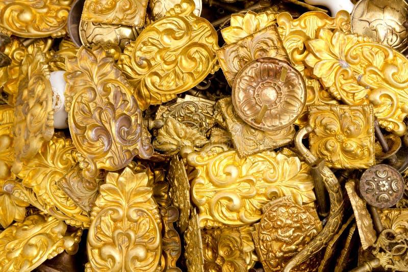 Parti decorative impresse del metallo dorato d'ottone fotografia stock