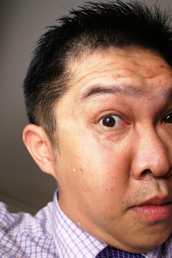 Partial anxious asian face