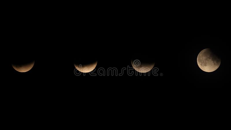 Partial Eclipse of the Moon July 2019. The partial eclipse of the moon 16th July 2019. taken from my garden in Stevenage. It was a bit cloudy so not too sharp stock photos