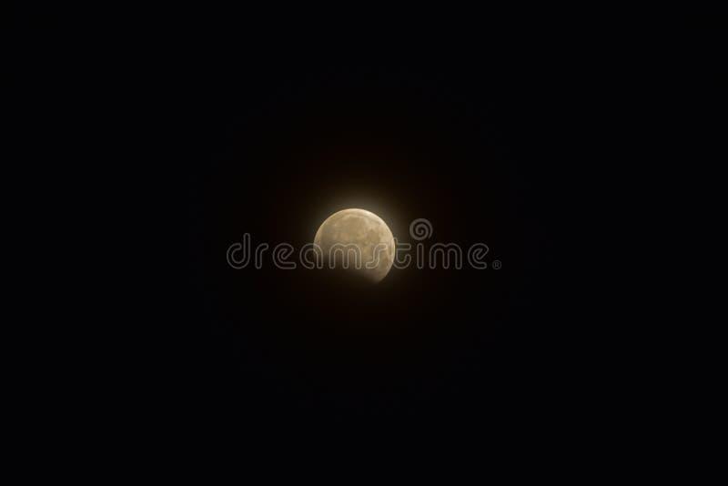 Partial lunar eclipse stock photos