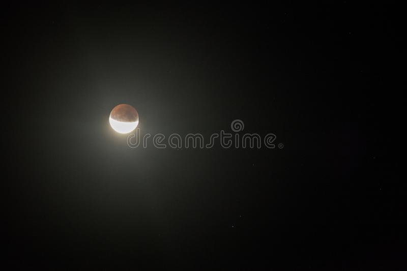 Partial lunar eclipse, Breaza, Romania, 17 July 2019. Partial lunar eclipse, the last lunar eclipse of 2019 seen from Breaza, Romania royalty free stock photography