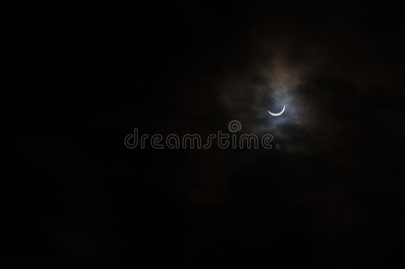 Partial Solar Eclipse on a Cloudy Day in Kristiansand Norway stock photo