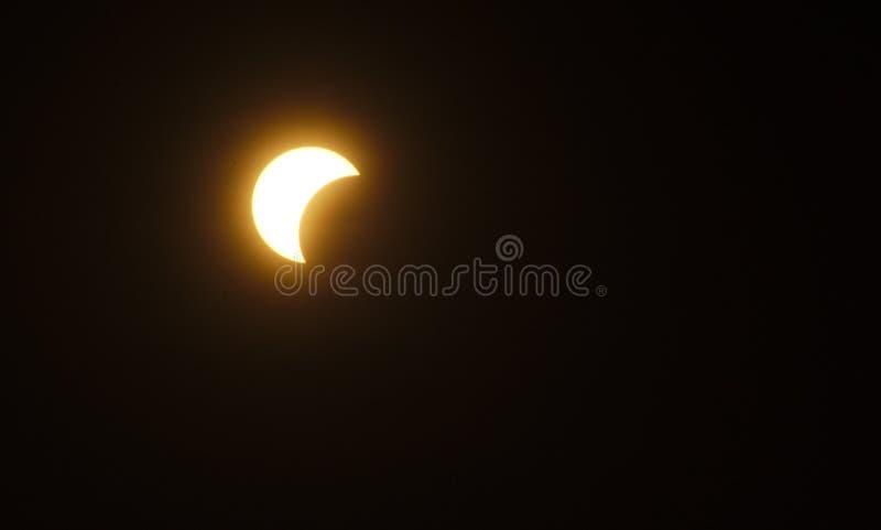 Partial Sun eclipse stock photos