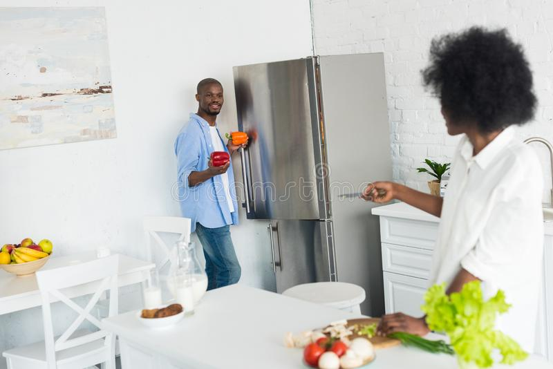 Partial view of african american cooking breakfast together in kitchen. At home royalty free stock photos
