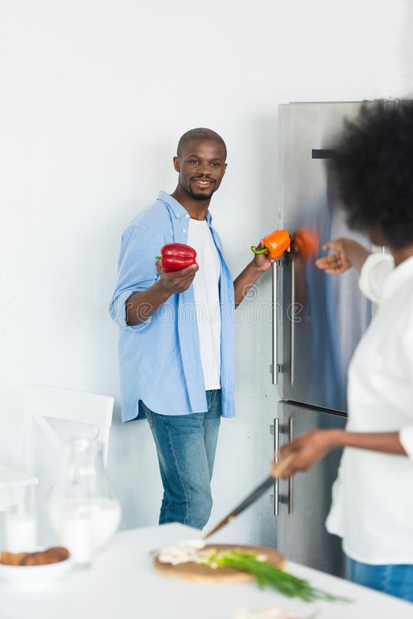 Partial view of african american cooking breakfast together in kitchen. At home stock images
