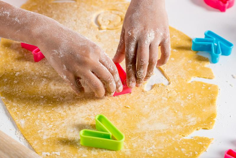 Partial view of african american kid making cookies. With letters cutters stock photo