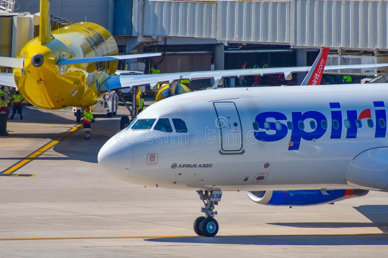 Partial view of airplane from Spirit Airlines NK  at the gate in Orlando International Airport MCO   1. Orlando, Florida.  March 01, 2019. Partial view of royalty free stock photos