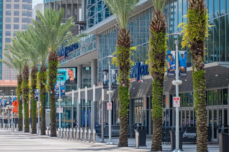 Partial view of Anway Center and palm trees at downtown area 95. Orlando, Florida. August 17, 2019. Partial view of Anway Center and palm trees at downtown area royalty free stock photos