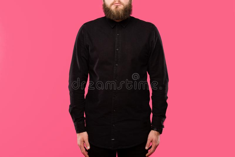 Partial view of bearded male hipster in black stylish shirt posing isolated. On pink stock photo