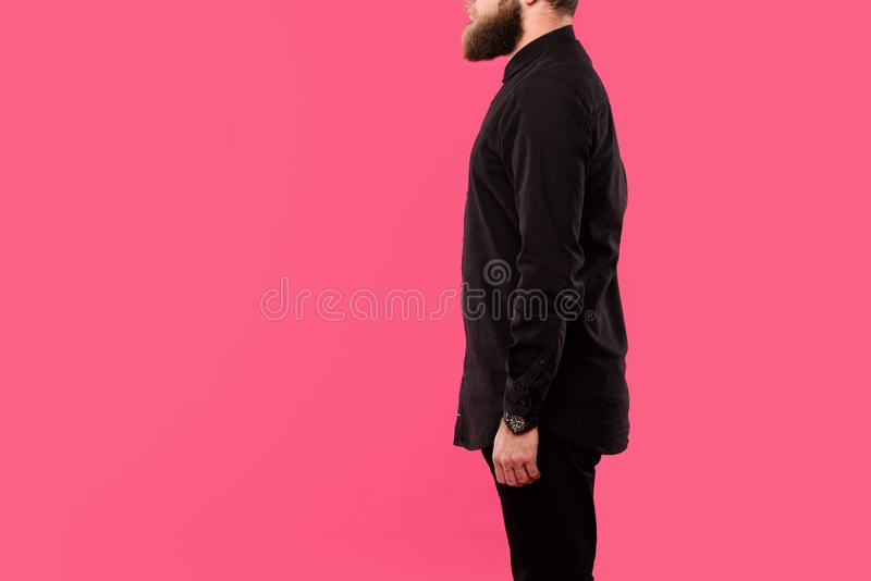Partial view of bearded man in black stylish shirt posing isolated. On pink royalty free stock image