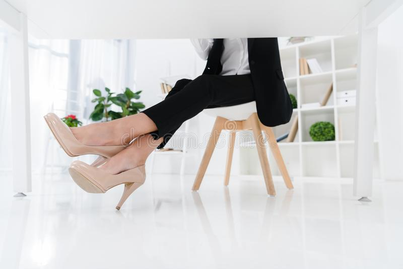 Partial view of businesswoman sitting at workplace. In office stock photo