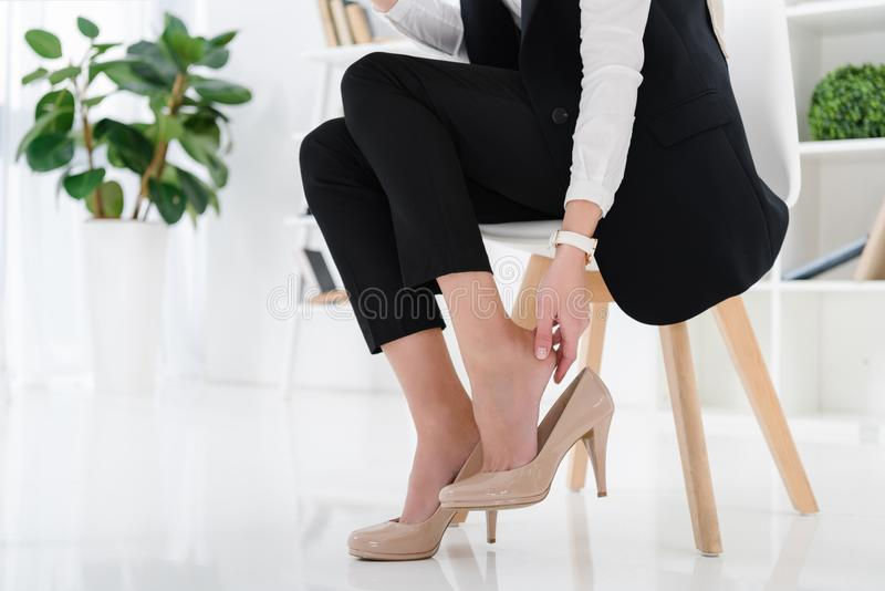 Partial view of businesswoman sitting at workplace. In office royalty free stock images