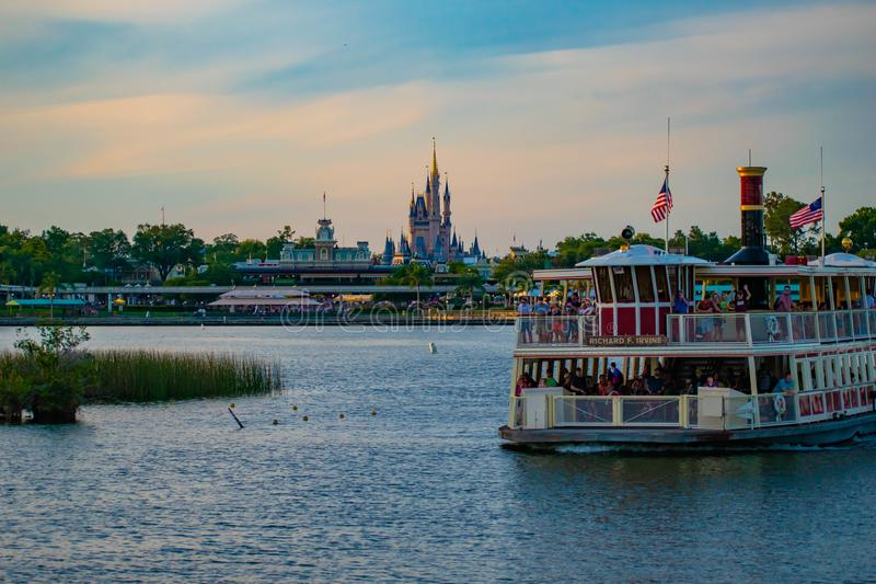 Partial view of Cinderella`s Castle and Disney Ferry boat on colorful sunset bakcground at Walt Disney World  area  1. Orlando, Florida. April 23, 2019. Partial stock image