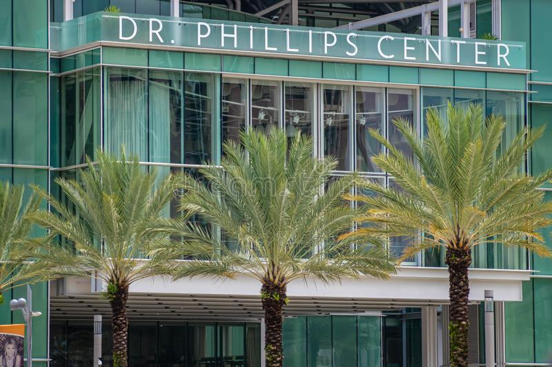 Partial view of Dr Philliphs Center and palm trees at downtown area 48. Orlando, Florida. August 17, 2019. Partial view of Dr Philliphs Center and palm trees at stock photo