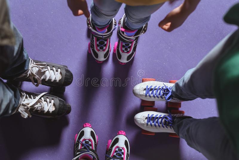 Partial view of family in roller skates standing. On roller rink stock image