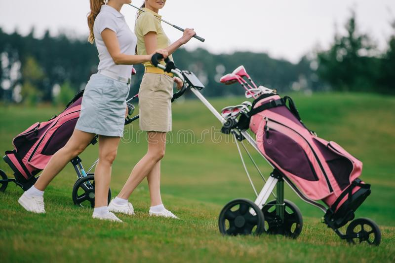 partial view of female golf players in polos walking royalty free stock image