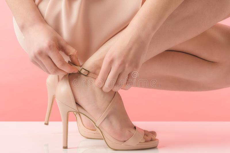 partial view of girl in pink heels, stock images