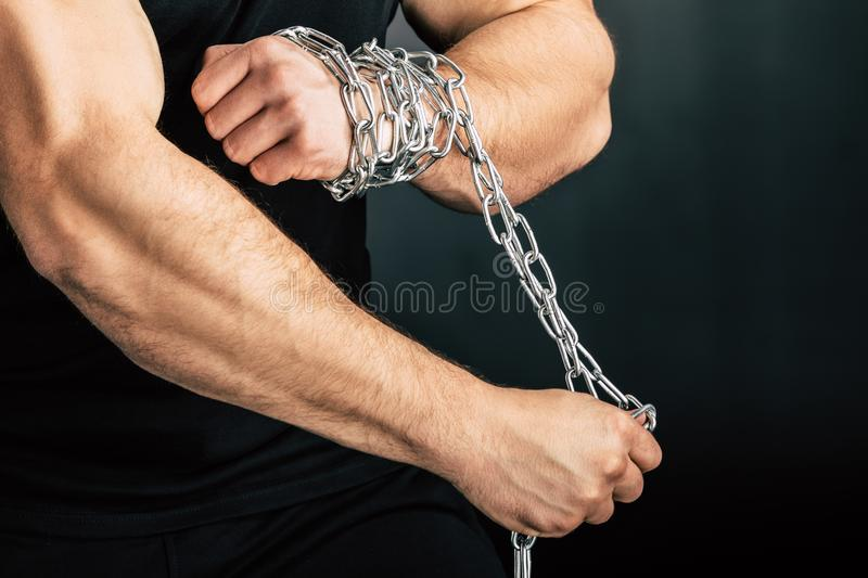 partial view of man with metal chain on hands royalty free stock images