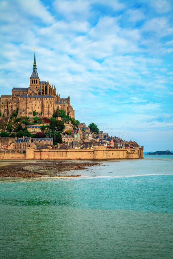 Low tide in front of historic Mont Saint Michel Normandy France. Partial view of Mont Saint Michel Normandy France with a low tide stock photo